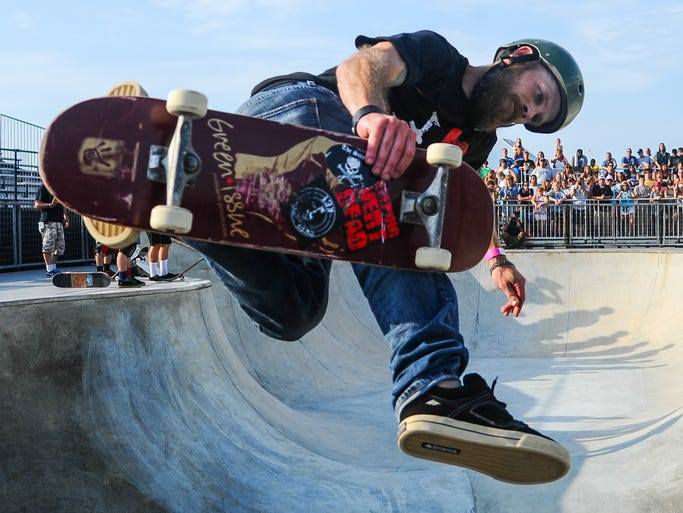 "Local amateur skaters skate among professionals during the ""Unlock The Bowl"" event on Wednesday afternoon at Dew Tour in Ocean City."