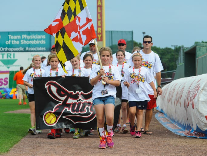 The Fury lead Maryland representatives during the USSSA Opening Ceremony parade at Arthur W. Perdue Stadium on Wednesday afternoon.