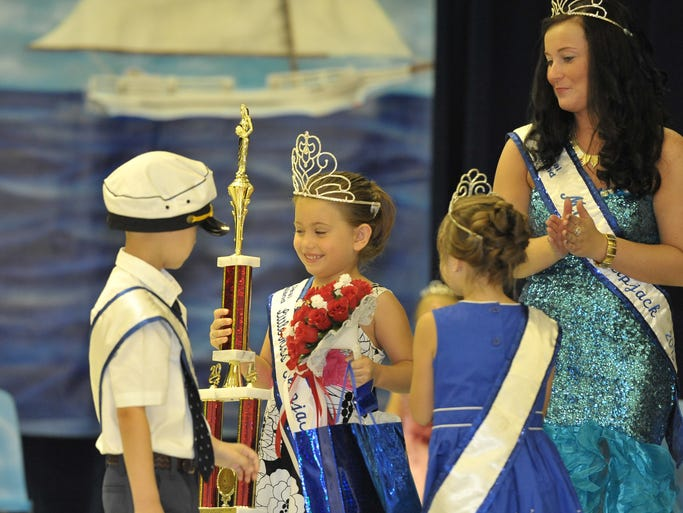 Emily Whitlock is announced as the new Little Miss Skipjack 2014 during the annual Miss Skipjack Pageant held at Deal Island Elementary School.
