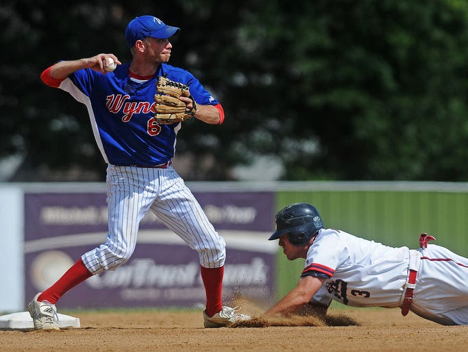 Wynot Expos infielder Matt Hames (6) winds up for a throw to first to complete a double play after forcing out Alexandria Angels' John Greicar (3) during the State Amateur Baseball Tournament class B Championship game on Sunday, Aug. 17, 2014, at Cadwell Park in Mitchell, S.D.