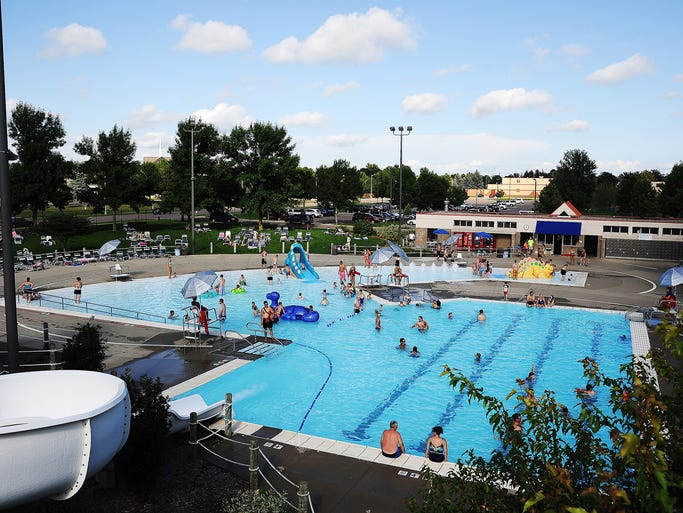 Adults and children play in the water on Sunday, Aug. 17, 2014, at Laurel Oak Family Aquatic Center, which closes for the season at 9 p.m. on Sunday, in Sioux Falls, S.D.