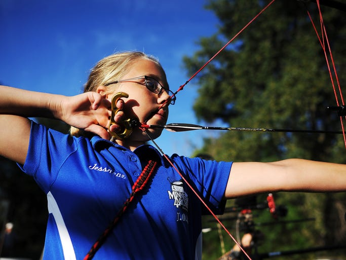 Jessarae Klatt, 11, of Sioux Falls, shoots her bow on Tuesday, Aug. 26, 2014, at the Minnehaha Archers Outdoor Range in Sioux Falls, S.D. Klatt, who shoots competitively and is a staff shooter for Scheels All Sports, has been shooting since she was 5 and started competing at the age of 9 through 4-H.