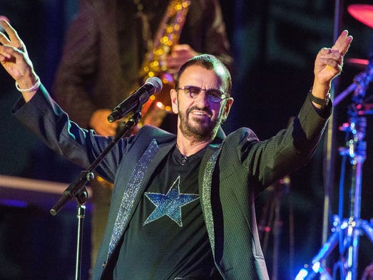 Musician Ringo Starr performs on stage with Ringo Starr