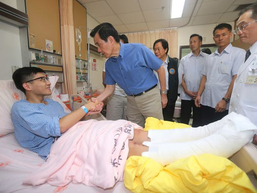 Taiwanese President Ma Ying-jeou shakes hands with