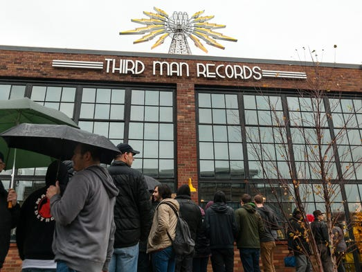 Hundreds of fans waited in the rain for their chance