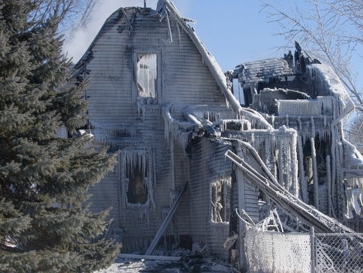 The remains of a house fire in Boxholm, Sunday, Jan.