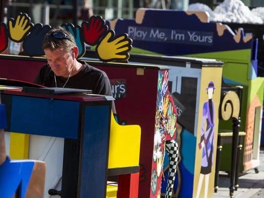 John Fillo plays one of 24 pianos at the Mesa Arts