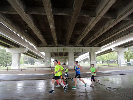 Runners pass under the Walnut Street bridge on Chestnut