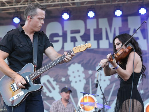 From left, artists Jason Isbell and Amanda Shires perform