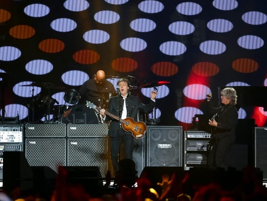 Singer/songwriter Paul McCartney performs on stage
