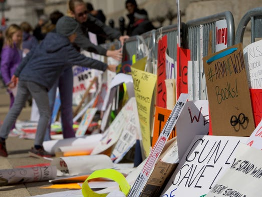 """Protestors pile up their signs after the """"March for"""