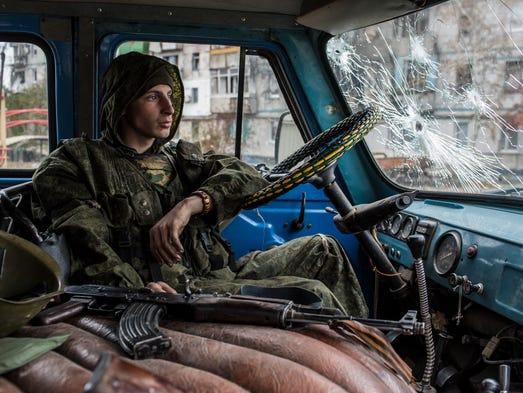A pro-Russian rebel fighter sits in a van in the Kievsky