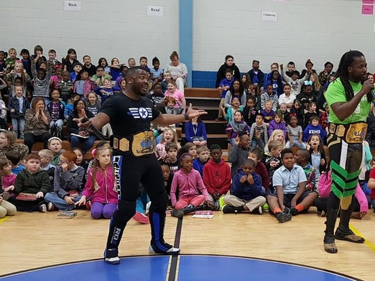 Pro wrestlers Big Daddy Yum Yum, Action Jackson and Flawless Jerome Daniels speak to students at Keithville Elementary about bullying on Wednesday.