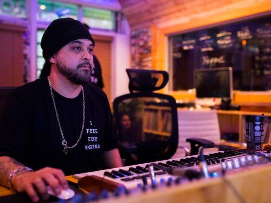 El Dusty works in his studio on Tuesday Feb. 6, 2018
