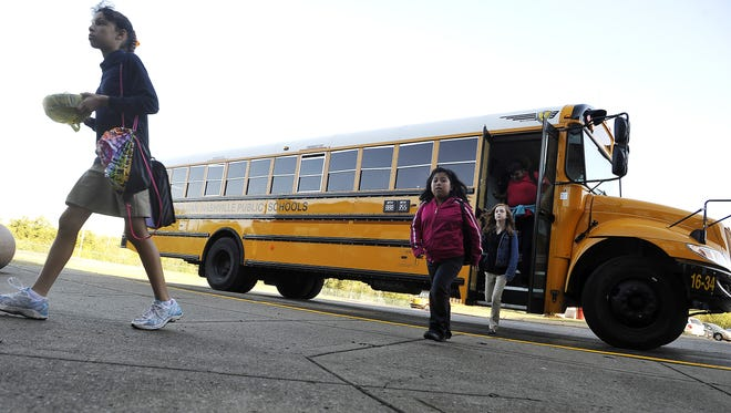 In this file photo, a bus arrives late for a school drop-off at Jere Baxter Middle School in the 2015-16 school year.