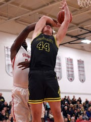 Tri-Valley's Tommy King is fouled by Amere Royster