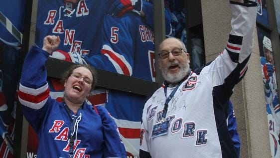 Rangers fans Kate Ginivan of Scarsdale and her father, Steve Bernstein of Dobbs Ferry, cheer for the Rangers on Monday as they prepare to enter Madison Square Garden for Game 3 of the Stanley Cup Final against the Kings.