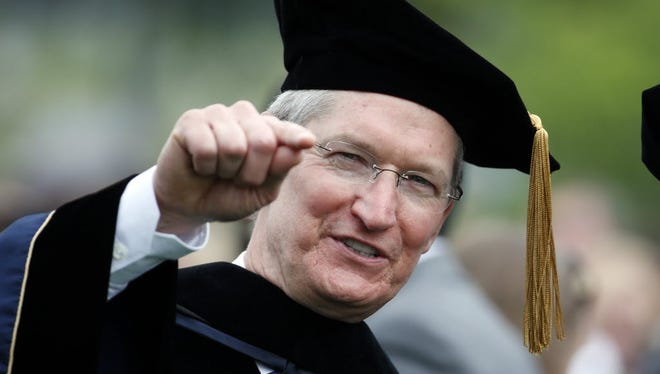 Apple CEO Tim Cook encouraged George Washington University graduates not to sit on the sidelines of life.