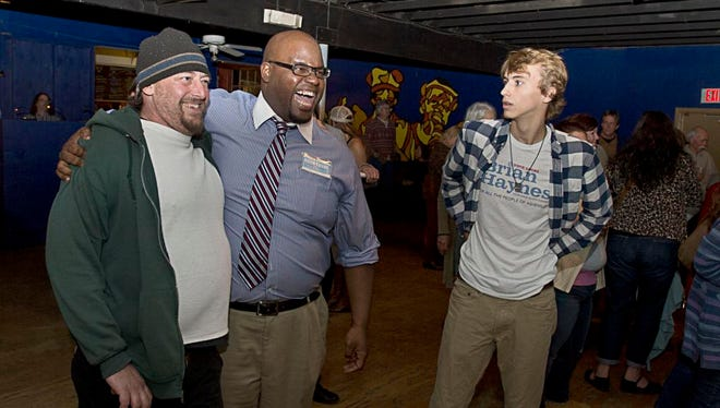City Council candidate Keith Young celebrates with a friend as he finds out he leads in the polls Tuesday November 3 at the Grey Eagle.