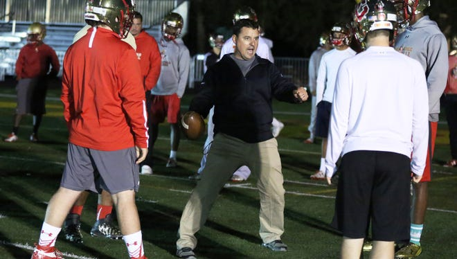 Bergen Catholic head football coach Nunzio Campanile, center, found a significant flaw in last year's power point formula, pointing out that because of residuals teams could get more points in a loss, than in a victory.