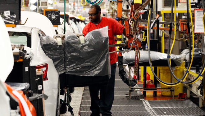 A technician uses a lift to move a back seat into a Nissan Altima on the assembly line at the Nissan Canton Vehicle Assembly Plant in Canton, Miss., in this 2016 photo. Auto dealers are concerned about border adjustment tax proposals being floated by the Trump administration and some members of Congress.