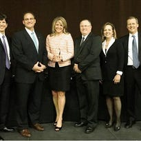 Johnsonville's Building Leaders And Superlative Teams leader development program won an Excellence In Practice award from the Association for Talent Development. Pictured are the president of ATD next to Johnsonville members Cory Bouck, Christine Adleman, Deron Poisson and the award emcees.
