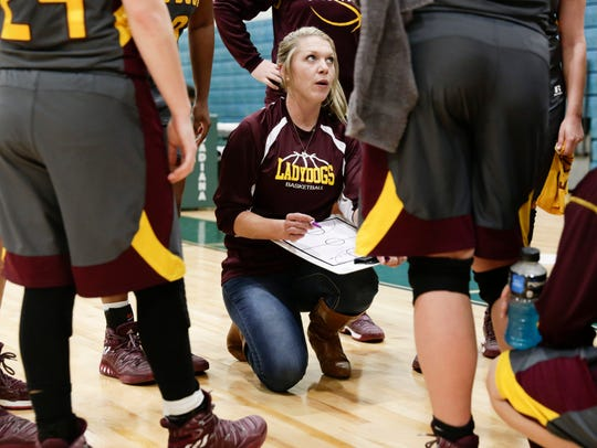 Iota Head Coach Meghann LeJeune directs players against
