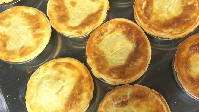 A pan of baked meat pies at Waltzing Kangaroo, an Australian fast food restaurant that opens on Monday.