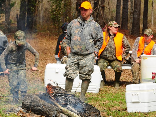 Participants in the Hero Hunt enjoy a day of rabbit hunting at the Felix DeJean hunting camp Saturday in Garland.