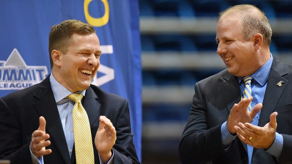 T.J. Otzelberger (left) shares a laugh with SDSU athletic director Justin Sell after he was announced as men's basketball coach in 2016. This week Otzelberger accepted the head coaching job at UNLV.