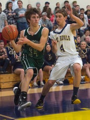 James Buchanan's Cody Tacker (34) tries to takes a shot but is guarded by Brandon Stuhler (4) of Greencastle during a boys basketball game in Greencastle, Pa. on Tuesday, Jan. 19, 2016. Greencastle beat James Buchanan 60-44.