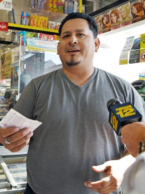 Paterson's Juan Mendez-Galarza bought a $ 1 million winning Powerball ticket at the W&R Mini Market & Deli on Nagle Street in Paterson.  Galarza appears in the store and finds out that he is a winner.