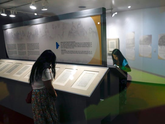 Visitors inspect the pages of the treaty of 1868 Friday