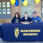 Zach Koehn signs to Finlandia University alongside his parents, Rich and Joddy Koehn.