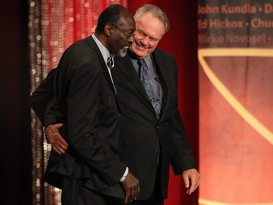 """Tom """"Satch"""" Sanders is hugged by Hall of Fame Player Tom Heinsohn (right) during the Basketball Hall of Fame Enshrinement Ceremony in 2011."""
