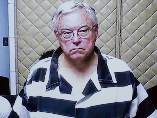 In this Feb.26, 2018, file photo, Roman Catholic priest Robert Deland is arraigned on one count of attempted second-degree criminal sexual conduct, one count of second-degree sexual conduct and one count of gross indecency between male persons via video from the Saginaw County Jail in the courtroom of Saginaw County District Judge M. Randall Jurrens in Saginaw, Mich.