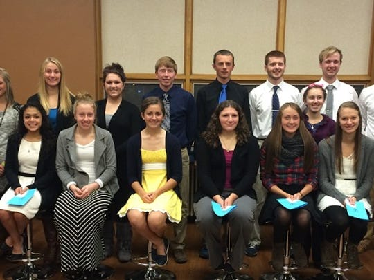 In early November, eight Columbus Catholic High School students were inducted into the National Honor Society. They join 11 returning members. According to NHS advisor, Ruth Fleischmann, students were chosen based on criteria in the areas of scholarship, service, leadership, and character. At CCHS juniors and seniors with a grade point average of 3.50 or higher are eligible to apply for National Honor Society. In addition, the school expects a minimum of 10 service hours per semester of high school. This year's applicants averaged more than 80 hours of service each before they entered NHS. NHS members must also continue their service. This year's group is choosing to perform their group service project by serving Fellowship Meals at St. Vincent de Paul's. New inductees are: (front row) Benjamin Alt, from left, Maria Virginia Garcia-Moya, Abigail Baierl, Ruth Schultz, Catherine Pinter, Rachel Roehl, Jessica Trad, Jessica Hall; and returning members are (back row): Kienan McIntee, Kelsi Selz, Hannah Stratman, Tara Brock, Ben Behling, Jeremy Binder, Zach Drexler, Catherine Anderson, Jake Bruce, Evan Hansen and Laura Wiskerchen.