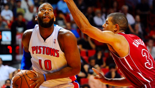 Detroit Pistons power forward Greg Monroe prepares to shoot the ball as Miami Heat small forward Shane Battier defends at American Airlines Arena.