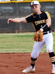 Alamogordo's Evan Best makes a throw over to first base.