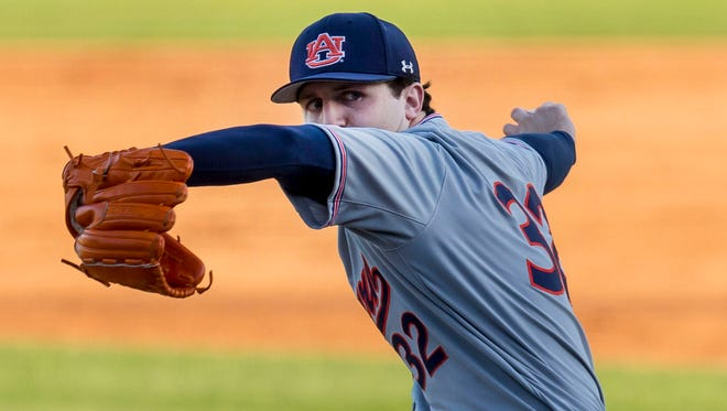 Auburn pitcher Casey Mize throws during a game in Tuscaloosa, Ala. on April 20, 2018.