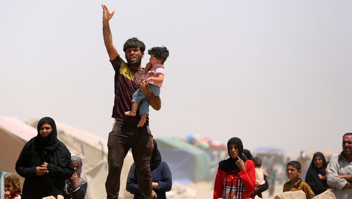 Displaced residents of Ramadi at an Iraqi refugee camp.