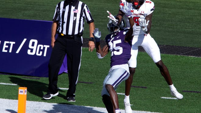 Kansas State Wildcats defensive back Ekow Boye-Doe (25) breaks up a pass intended for Texas Tech Red Raiders wide receiver T.J. Vasher (9) on Oct. 3 at Bill Snyder Family Football Stadium in Manhattan.