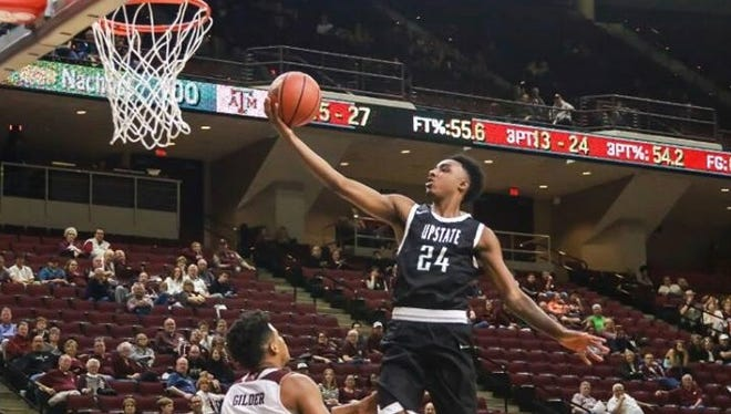 Erwin alum Malik Moore is a sophomore forward for the USC Upstate basketball team.