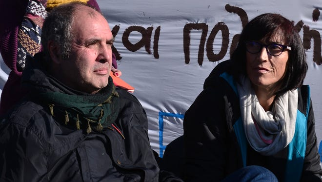 "Mikel Zuloaga and Begona Huarte, members of the Basque group, ""Refugees welcome"","" give a press conference in front of the Greek Parliament on Jan. 4, 2017 after they were arrested for trying to smuggle eight asylum-seekers from Greece to Spain."