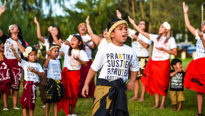 Kaipo Aquino, 8, chants as fellow members of the Guma Kimalamten I Taotao Tano cultural group performs a Chamoru blessing during the Asan Landing Memorial ceremony on Saturday, July 14, 2018.