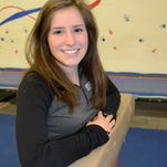Brighton's Margo Mekjian took most of last summer off, then returned to repeat as the All-County gymnast of the year.