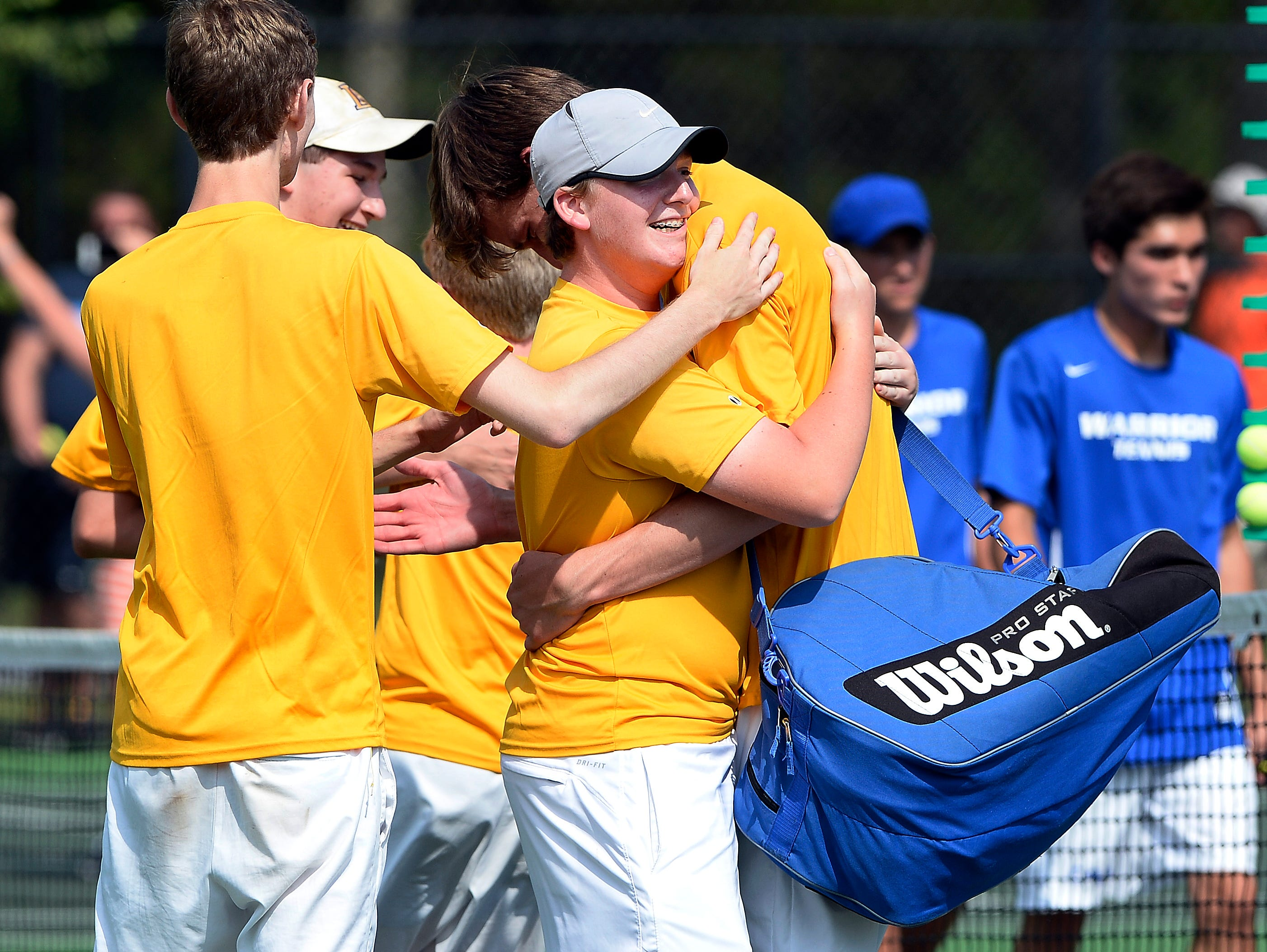 Lipscomb High School players celebrate after defeating Christian Academy of Knoxville 4-2 during the Tennessee Class A-AA boys team tennis championship final Wednesday, May 25, 2016, in Murfreesboro, Tenn.