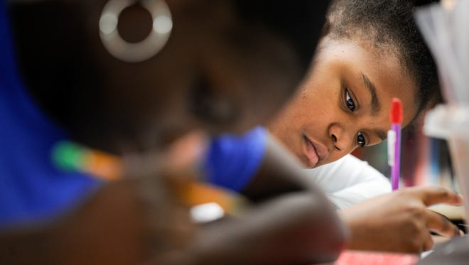 Sariya Lowery-Mathews works on her test in Anna Hoskins' fifth-grade class Feb. 10, 2017, at I.T. Creswell Middle Prep in Nashville.