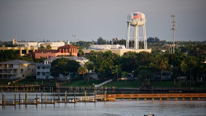 Part of Stuart's downtown waterfront, at the end of South Colorado Avenue, is seen over the St. Lucie River from the Roosevelt Bridge in this photo taken Aug. 5, 2014. The city will increase its water and sewer rates 5 percent annually for the next five years to pay for a slew of projects.