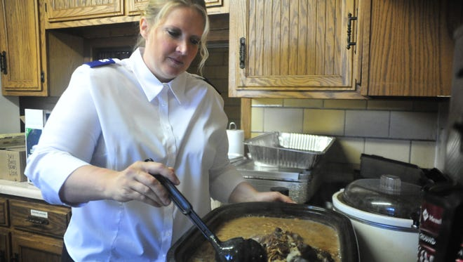 Heidi Valdez stirs soup this week at the Salvation Army in Bucyrus.